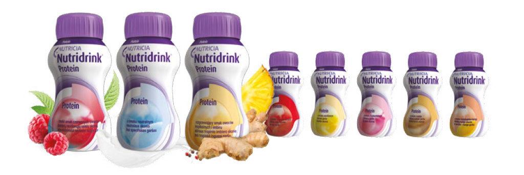 Butelki nutridrink stojące obok siebie, różne smaki